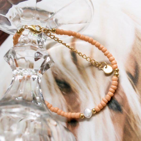 Handgemaakte armband orange pearl